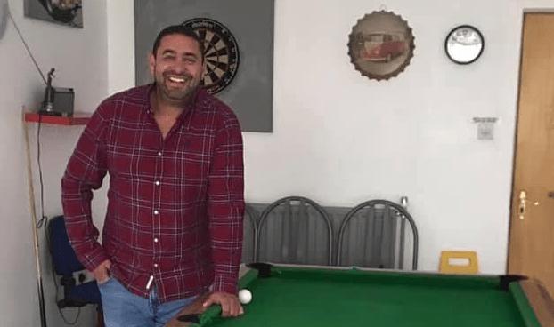 Emir beside a pool table